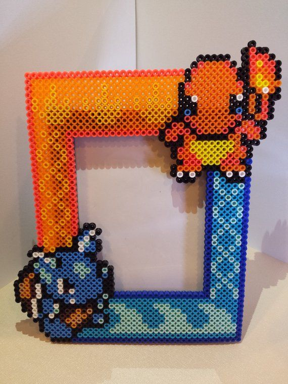 Photo of Charzard & Wartortle Battling Elements Perler Bead Picture Frame