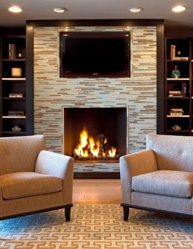 fireplace and glass tiles with tv set above the mantel do in a rh pinterest com
