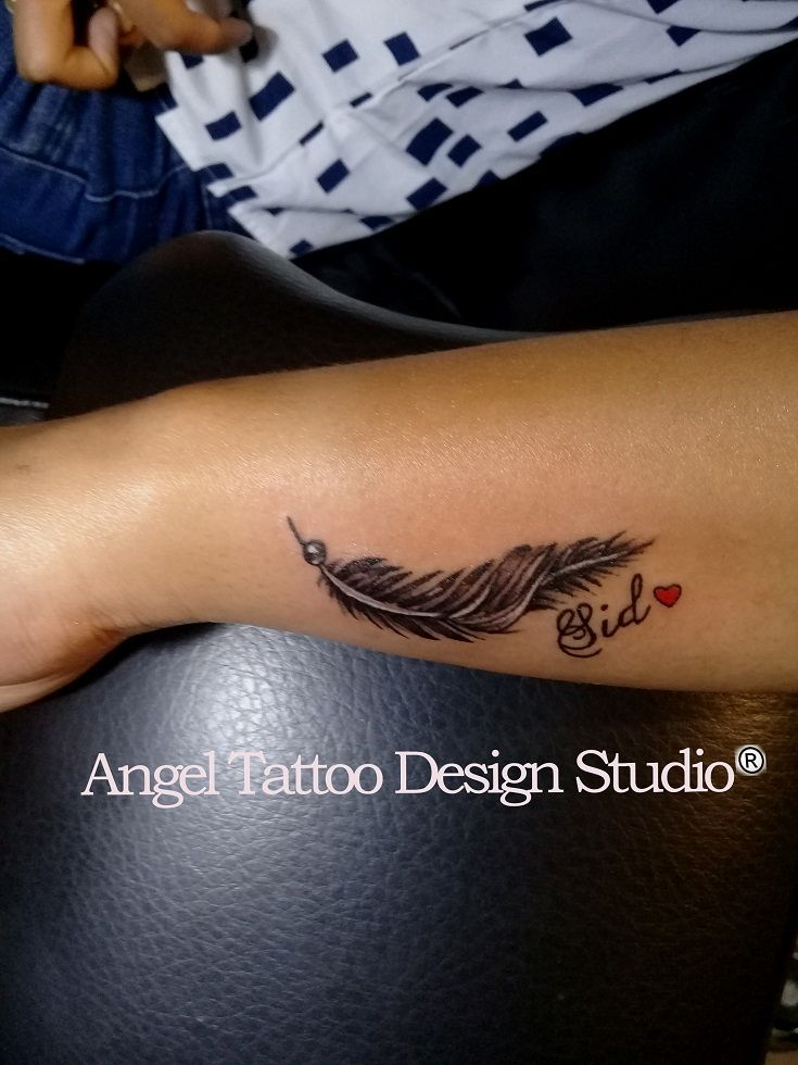 Feather with name tattoo on wrist made in gurgaon angel