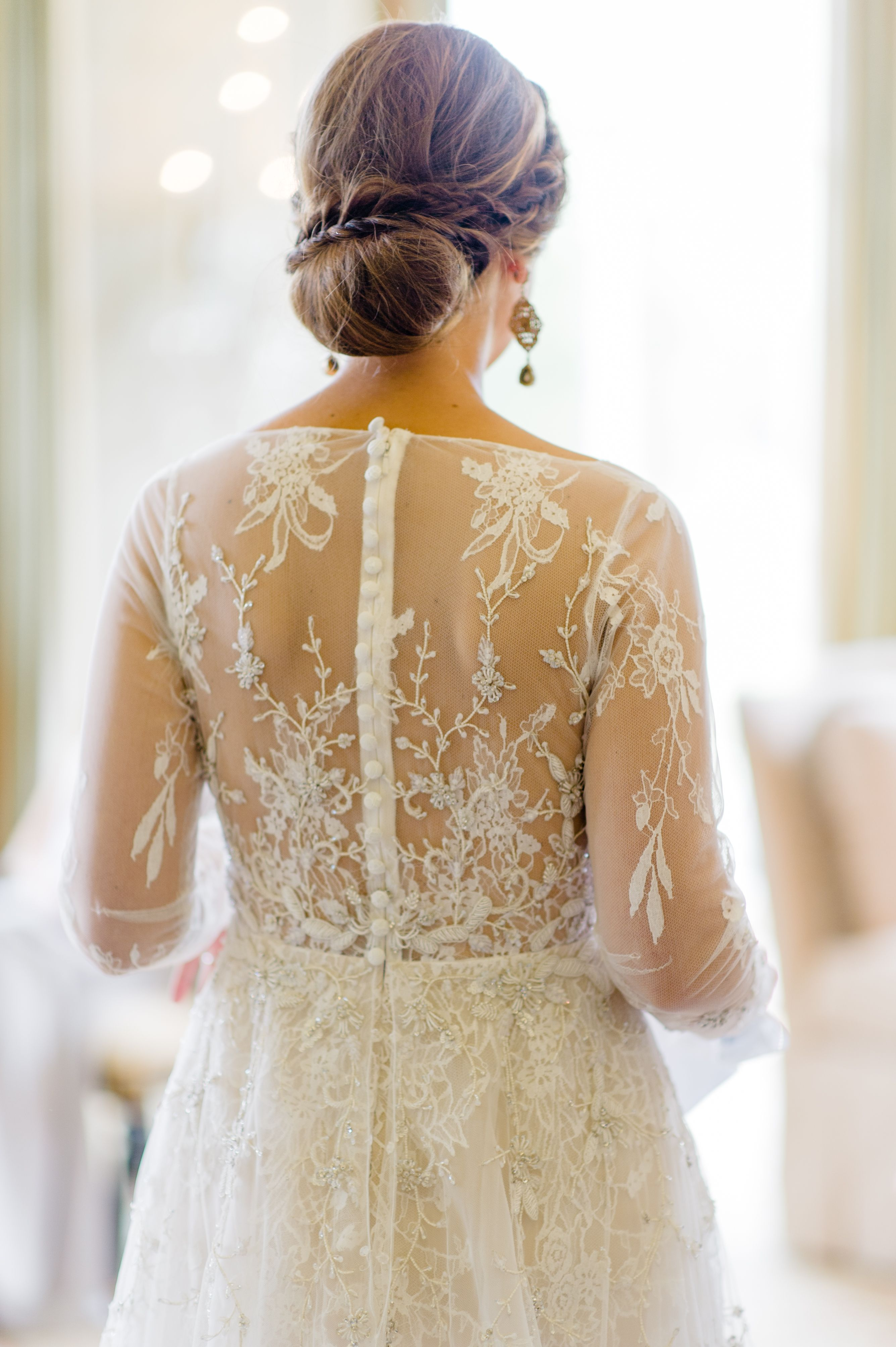 An elegantly romantic updo hairstyle for the bride with a braided