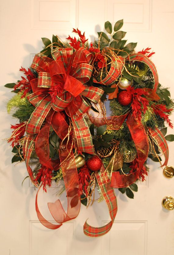 the addition of gold ornaments and the spectacular bowslovely christmas colored ribbonjust lovely