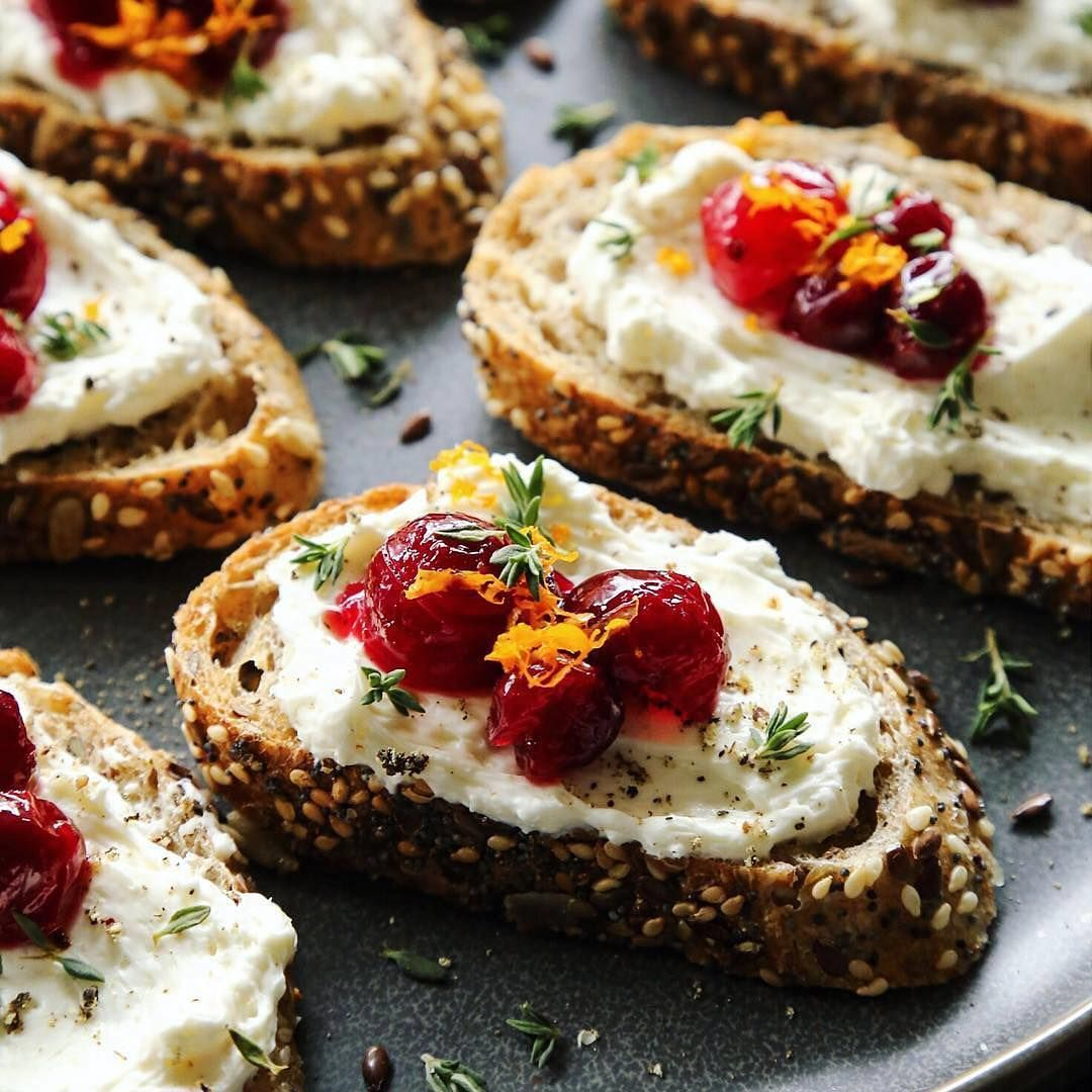 Got leftover cranberry sauce? @farmgirlsdabble shows us one of her favorite before-dinner nibbles, crostini with cream cheese spread, a bit of cranberry sauce, with a dash of fresh orange zest and thyme leaves.
