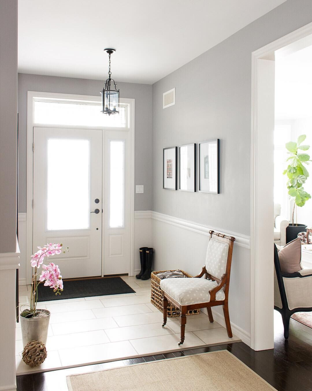 entry way with chair rail and white and gray paint. Vintage chair