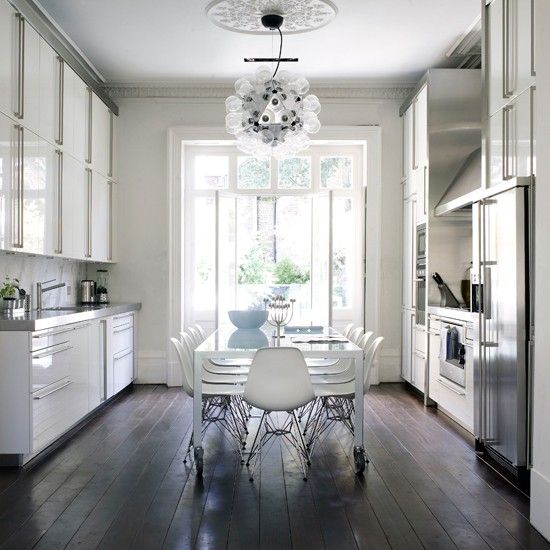 Love the dark floorboards (with a grouping of mooi lamps over a kitchen island)