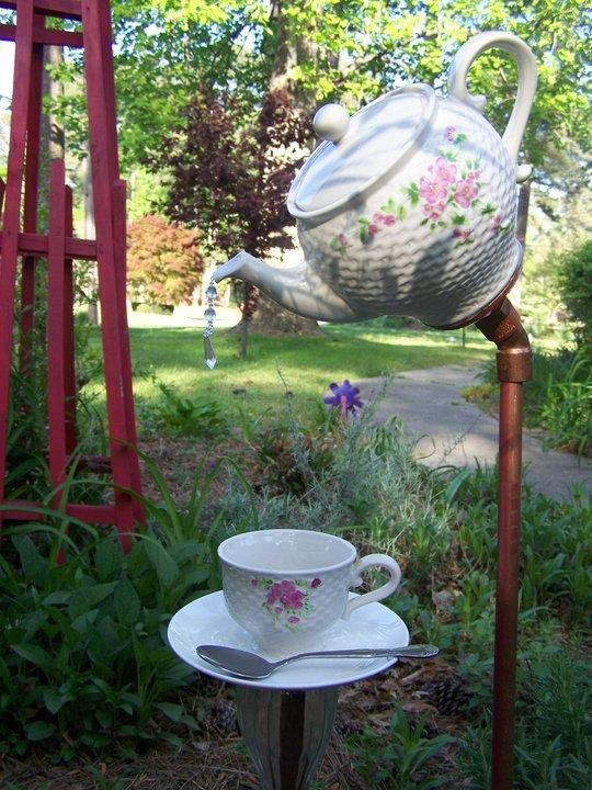 Teapot Pouring Into Tea Cup Yard Art. Crystal Drips From Teapot Spout.