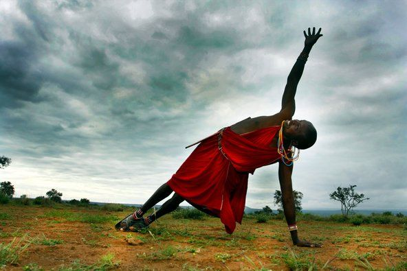 Yoga in Africa: A Masai tribesman, Jacob Parit Noomek, does yoga in the foothills of Mount Kilimanjaro | NYTimes.com
