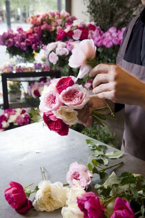 Flower arrangement in hues of pink.