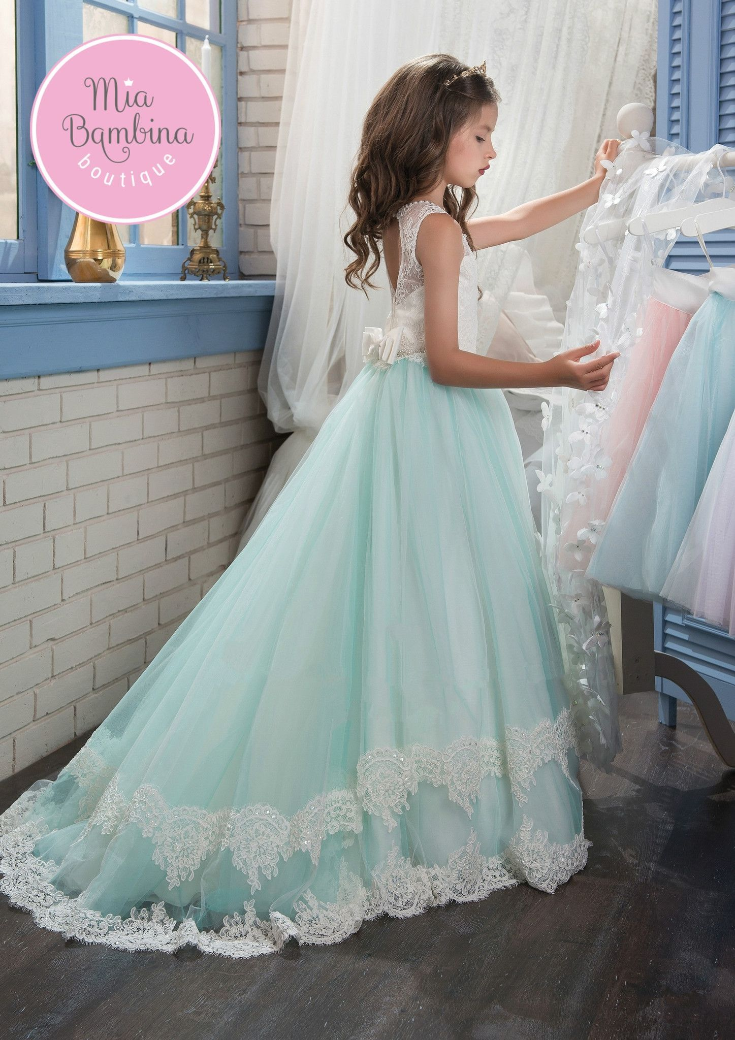 The Birmingham is an adorable gown with a train for a whimsical wedding.  The dress features an illusion neckline with lace overlay bodice. 1dbbc85a6