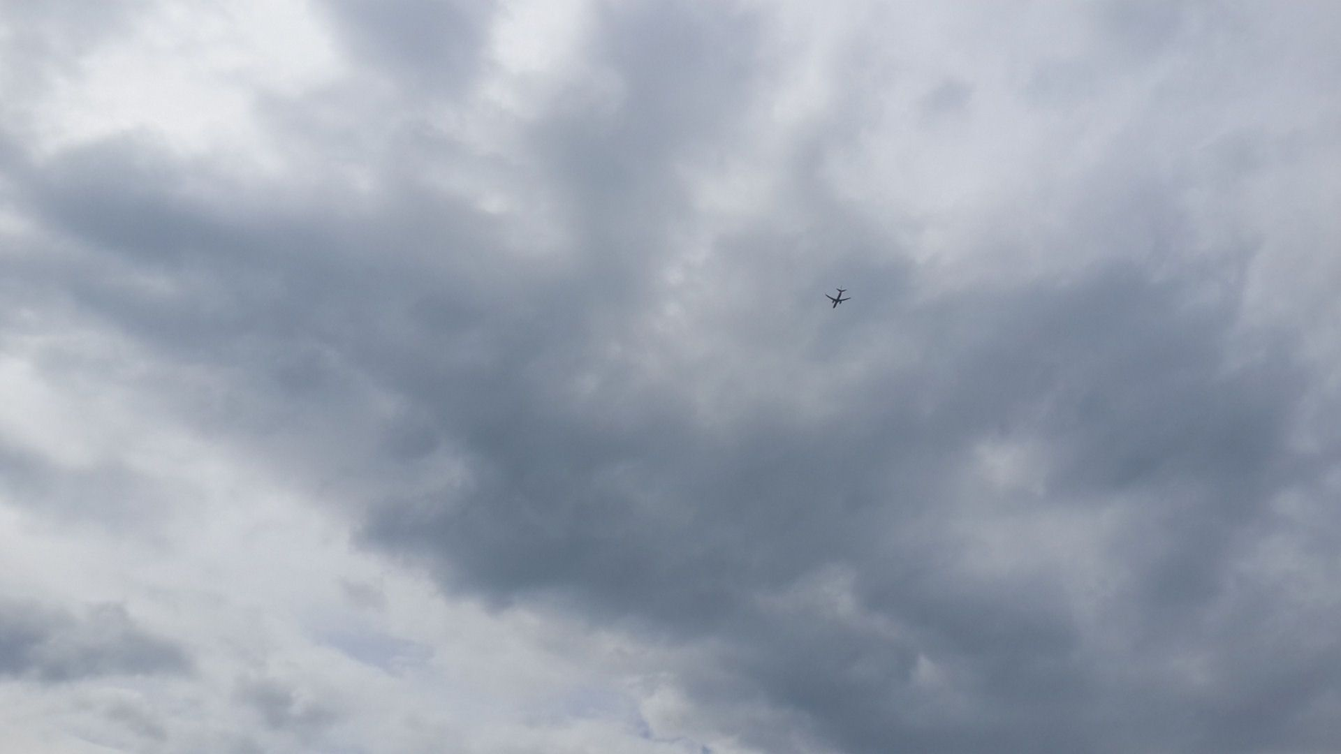 Plane in cloudy sky. Photo by Nail Eser.