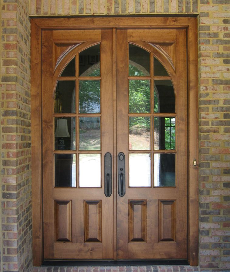 Brown Wooden French Country Double Door With Two Panel And Curved Glass Using Black Handle Combined Brick Wall Front Doors
