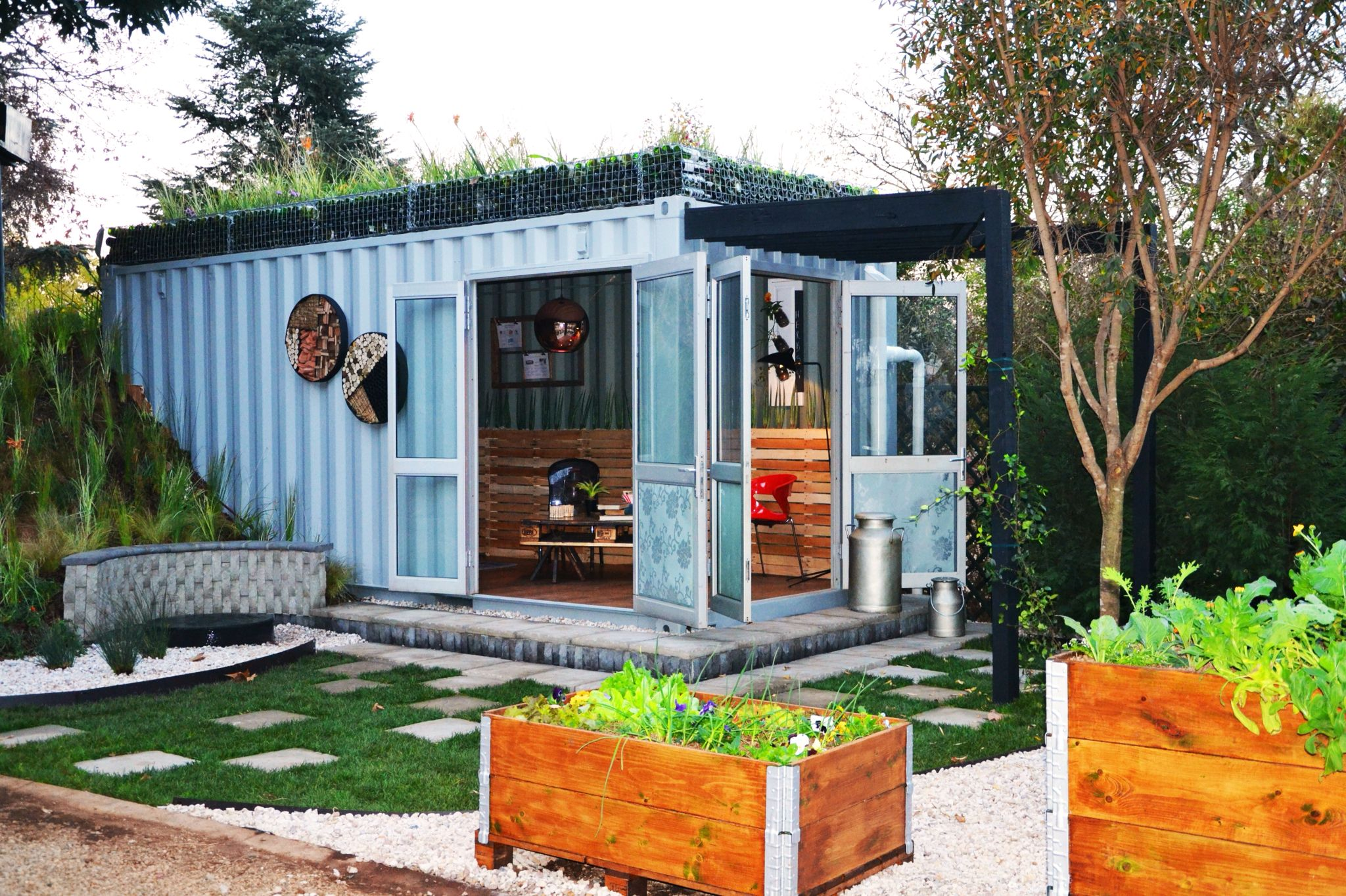 Shipping container converted into an outdoor living space. Roof ...