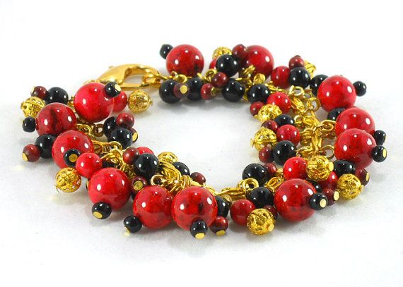 Red, black and gold beaded charm bracelet by TheBeadedCatsEye
