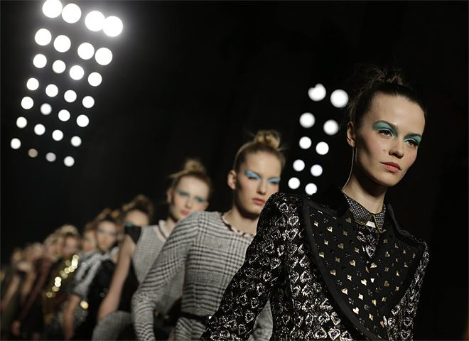 A model wears a creation for Aquilano Rimondi women's Fall-Winter 2013-14 collection, part of the Milan Fashion Week, unveiled in Milan, Italy, Saturday, Feb. 23, 2013. (AP Photo/Luca Bruno)