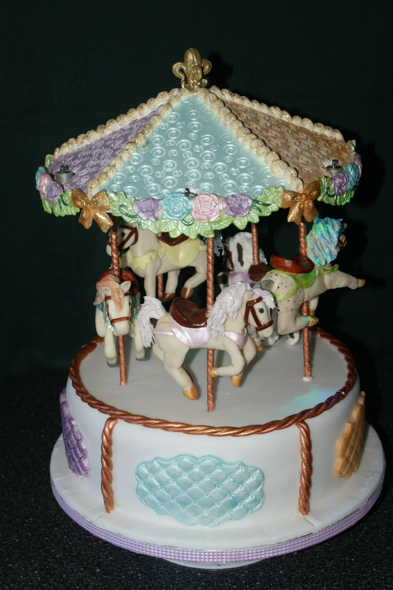 Carousel cake made for my daughter sitting on a