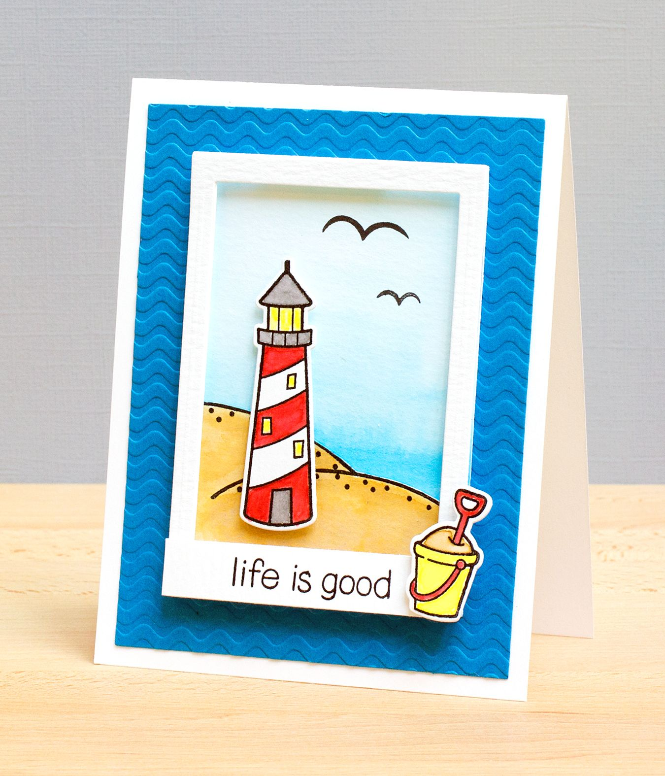 Handmade card lawnfawnlifeisgood lighthouse shor scene card summer lighthouse lawn fawn life is good sea beach seaside life by the sea sand castle bucket crab summer living relax life is good kristyandbryce Choice Image