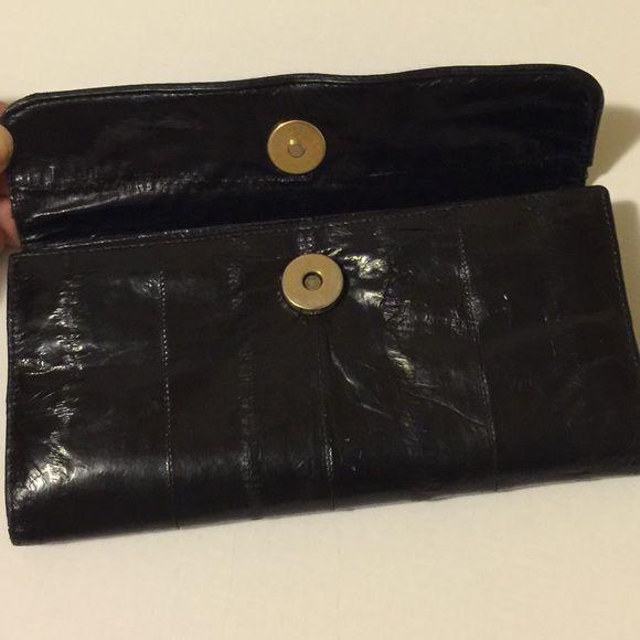 GONE TOMORROWVintage 1980s EELskin Wallet Vintage 1980's genuine eelskin wallet, fold up, snap closure, zipper pocket, multiple compartments inside. Black. Bags Wallets