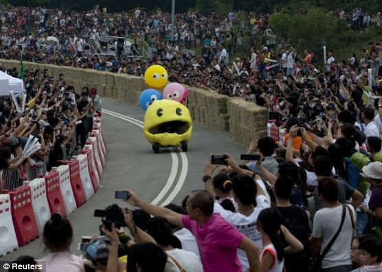 A competitor rides a home-made vehicle without an engine on a 600-metre-track during the Red Bull Soapbox Race in Hong Kong October 14, 2012. The race is judged on speed, creativity and showmanship, with competitors having to navigate their home-made human powered vehicles on the track in the best time.