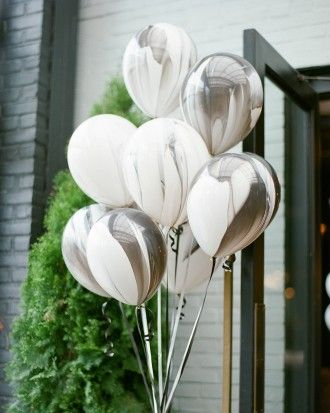 The marbled balloons from NY Balloon & Basket Co. marked the venue entrance and added something fun that still fit the overall décor