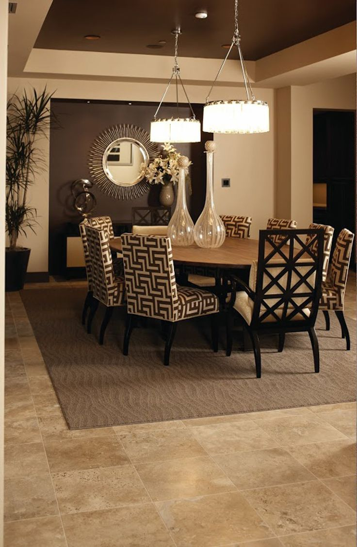 Combining Stone Tile Flooring With A Coordinating Area Rug Adds A