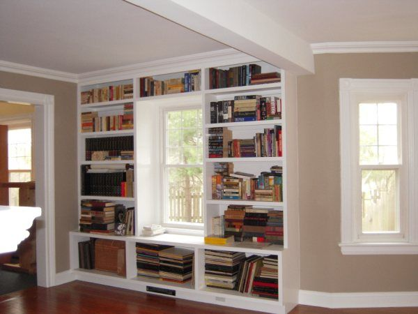 Molding top of bookcase flows into crown molding of room ...