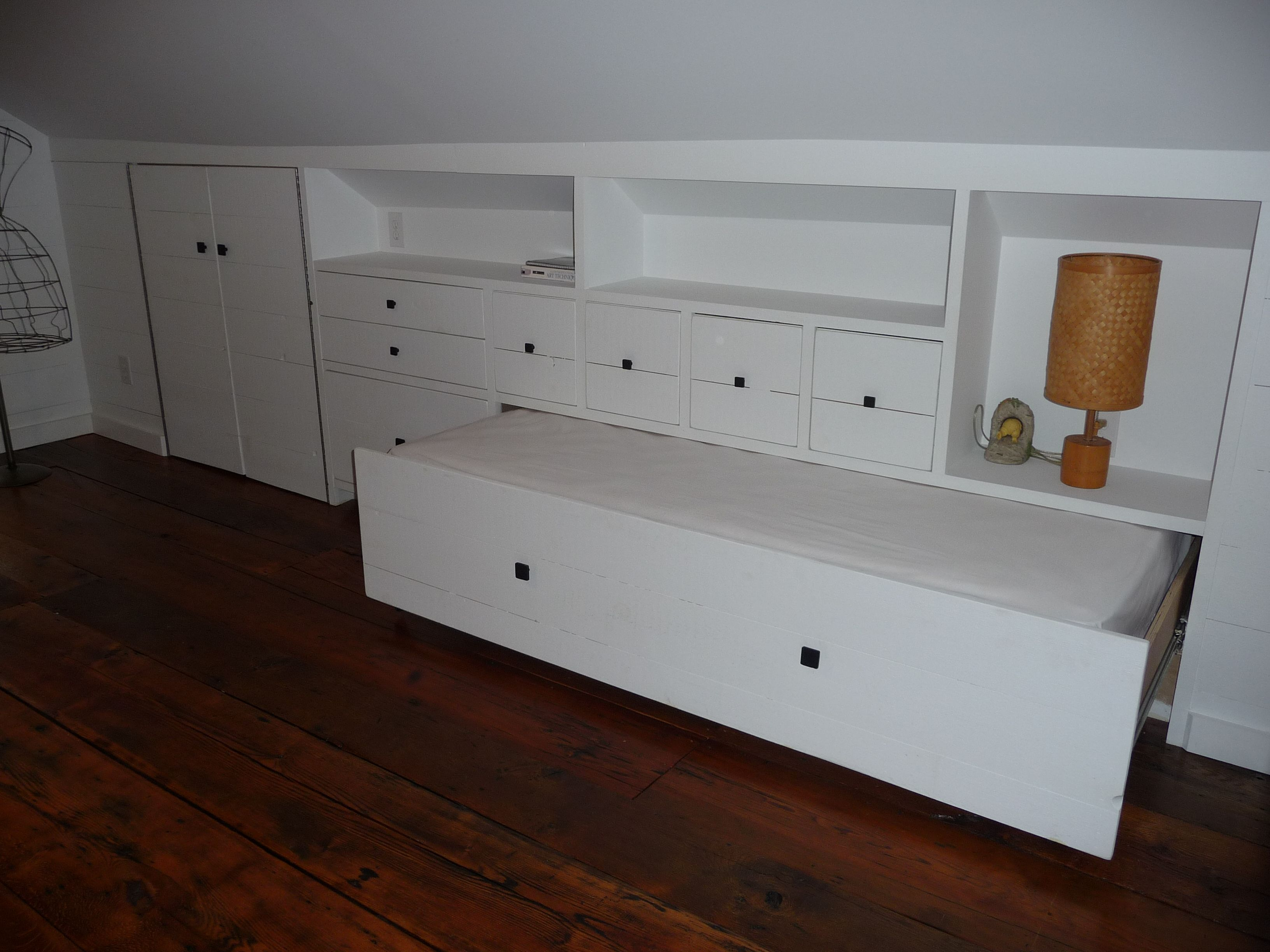 renovated attic bedroom w/ bed in a drawer. custom designedlq