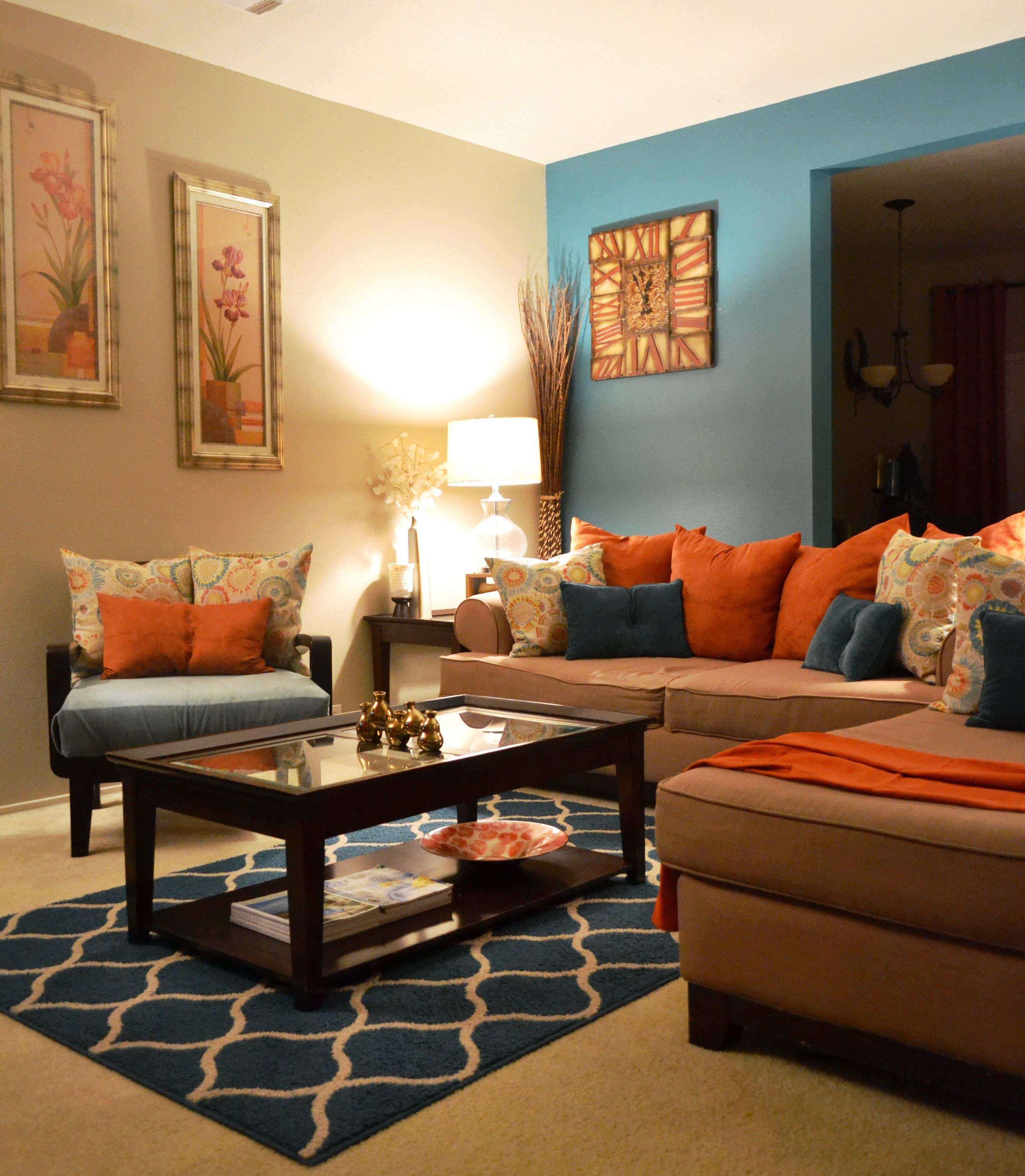 rugs, coffee table, pillows, teal, orange, living room