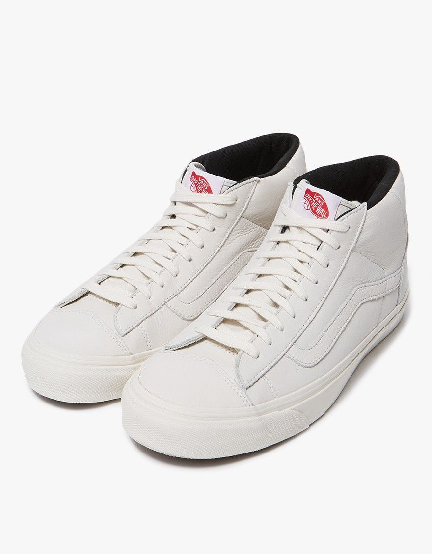 bf2271f562 Classic mid-top sneaker from Vault by Vans in Marshmallow. Nubuck upper.  Lace-up front with flat woven laces. Padded collar with debossed logo at  heel.