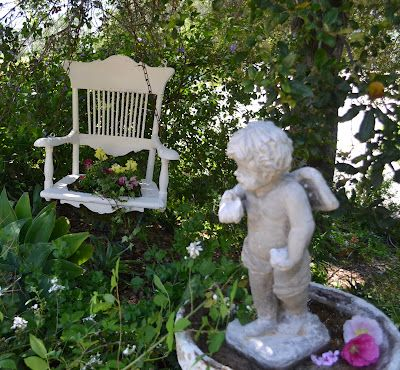 Really cute planter for the garden from an old chair.