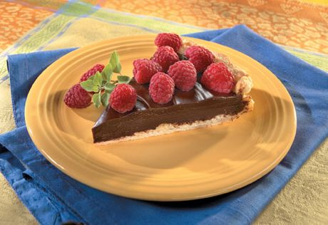 Rich semi-sweet chocolate fills a flaky puff pastry crust, and is garnished with fresh berries for an easy, but elegant dessert.
