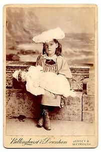 Vintage cabinet card of girl with doll