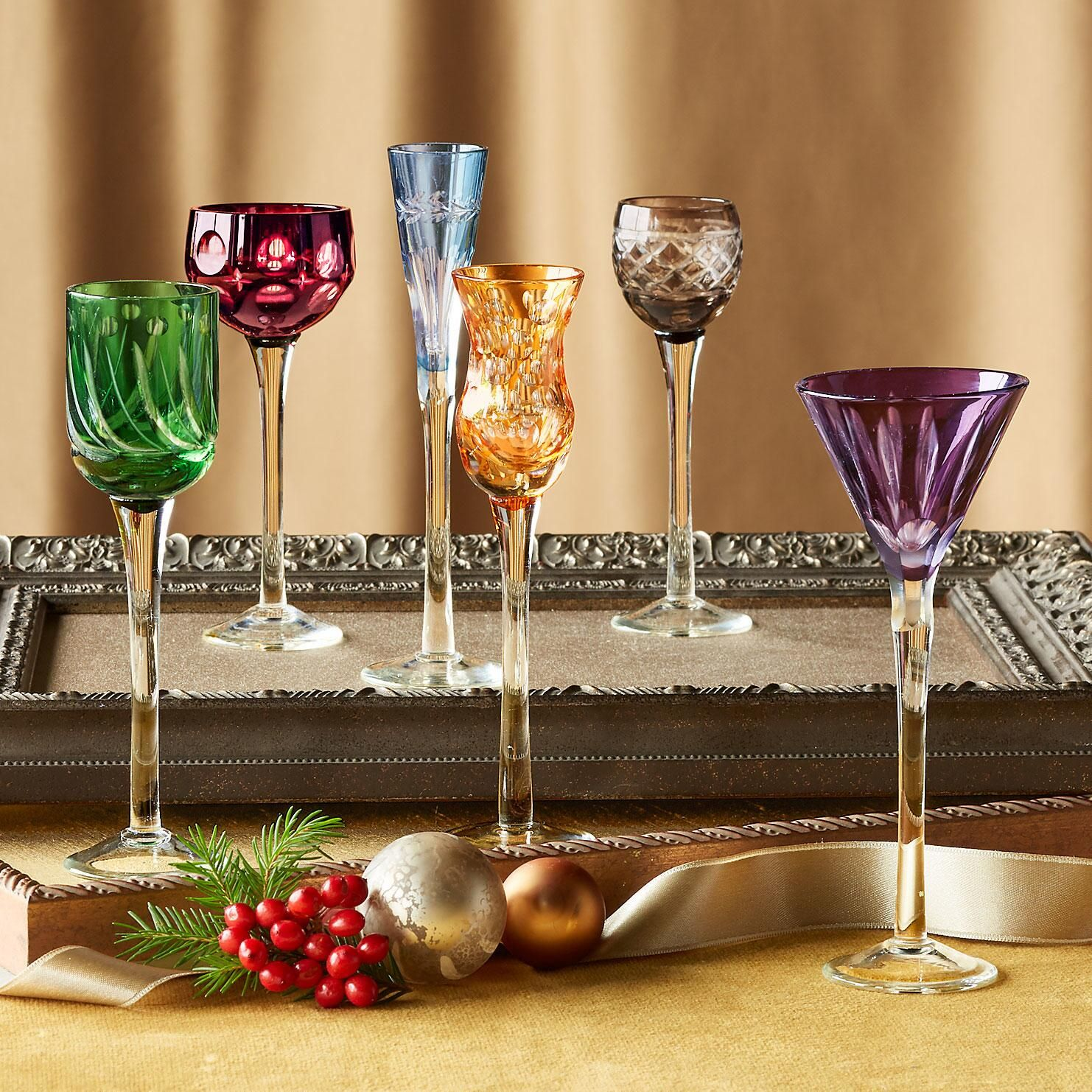 """PETITE FLUTES FOR A FêTE--Slender stems, each a different shape and color. Mouth-blown glass is dipped in color, then hand etched in individual patterns. Imported. Set of 6. 5-1/4"""" to 6-1/4""""H."""