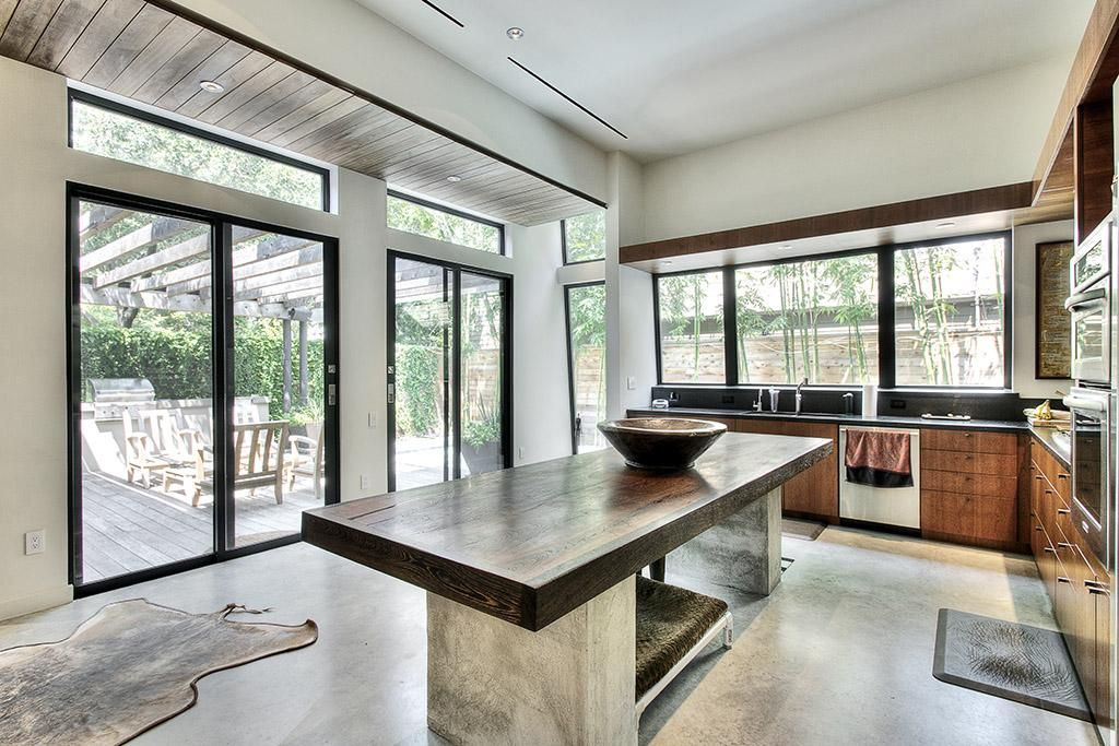 Kitchen With Etched Granite Counter Top 12 Ft Ceiling Concrete
