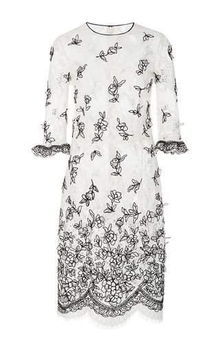 This **Oscar de la Renta** dress features a round neckline, three quarter length sleeves with ruffled cuffs, and all over floral embroidery.