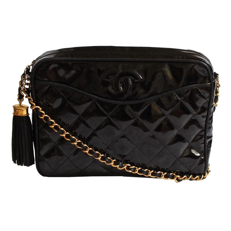0ce7a2b7ce98 1stdibs.com | 1990's CHANEL black patent leather quilted bag with gilt  hardware & tassel