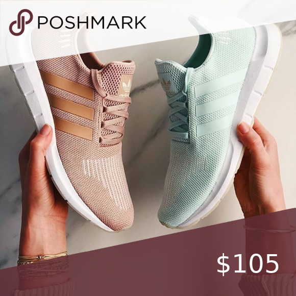 Adidas rose gold or light blue sneakers