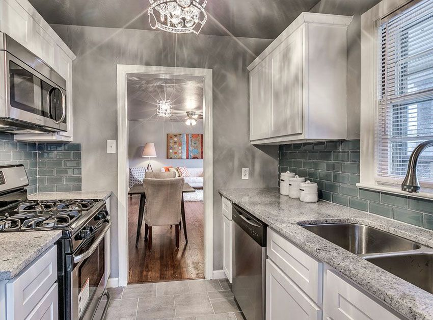 Beautiful Small Galley Kitchen With White Cabinets Juparana Delicatus Granite And Porcelain Tile Floors