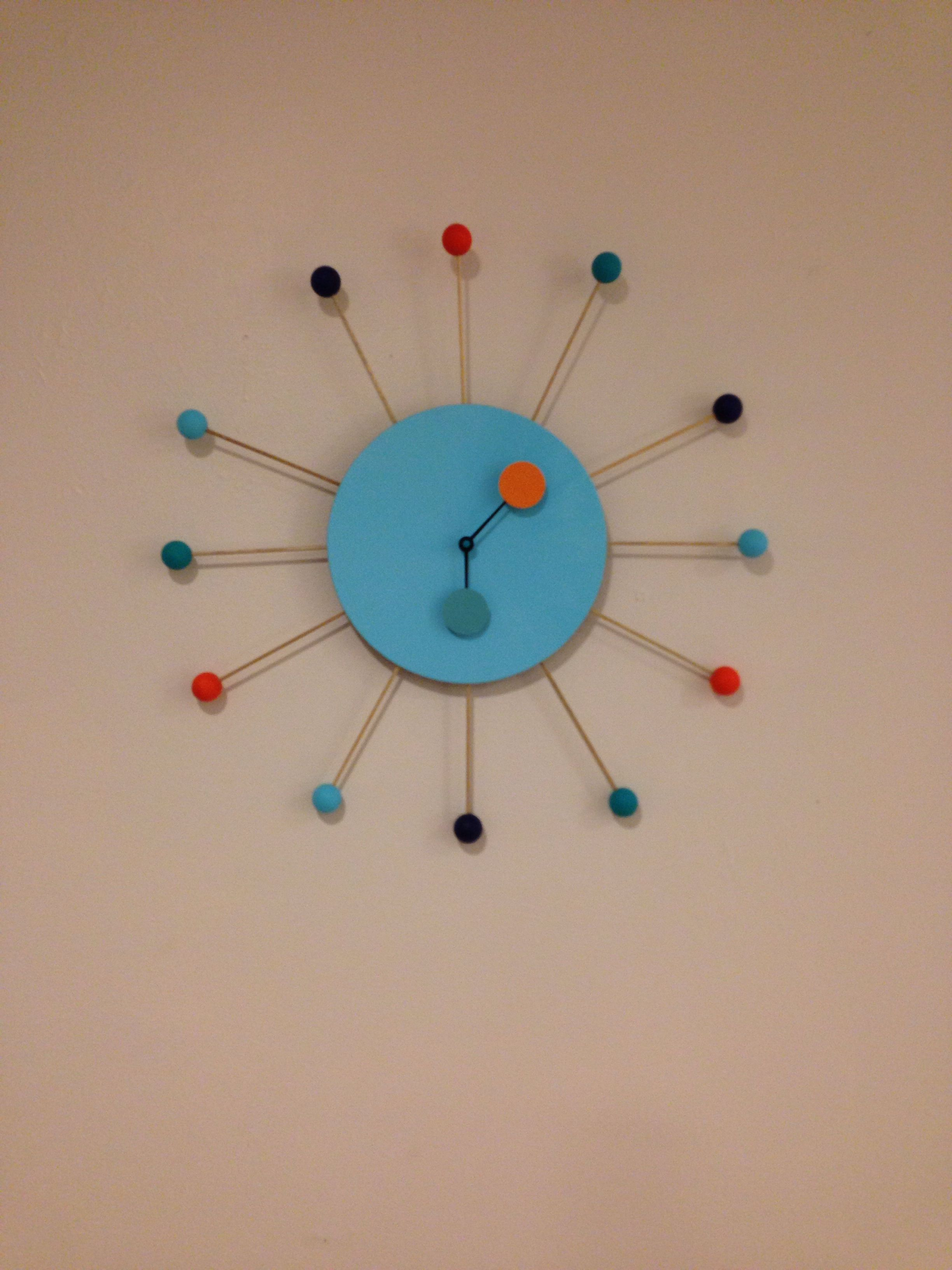 Clock- wooden beads and wooden dowels attached to painted thrift store clock. Paper circles attached to hands.