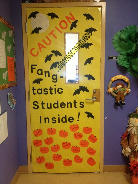 caution fangtastic students inside write your students names on bats andor pumpkins for this october classroom door decorating idea