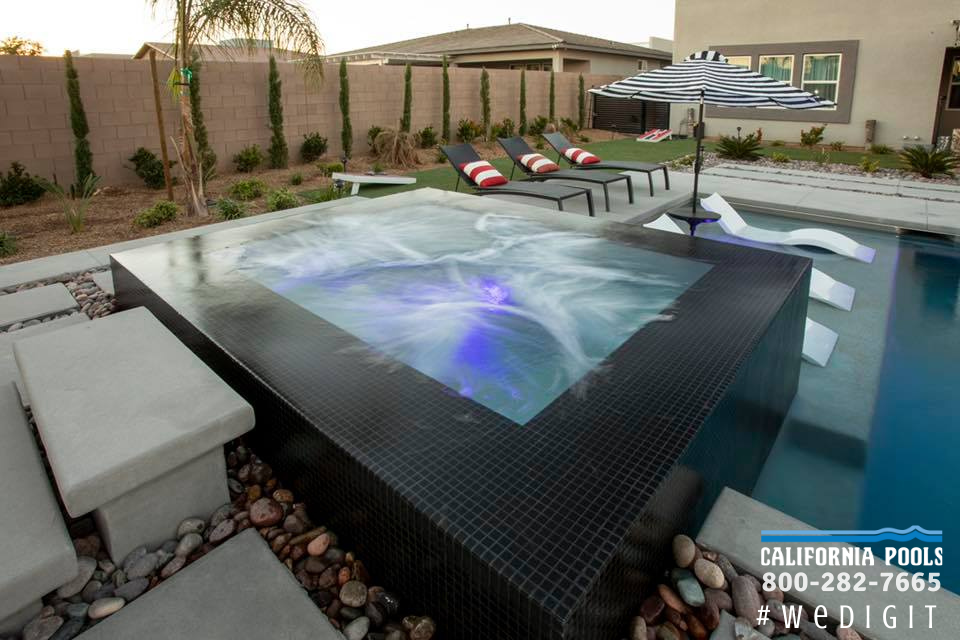 This Rim Flow Spa With Black Mosaic Tile Definitely Has Wow Factor