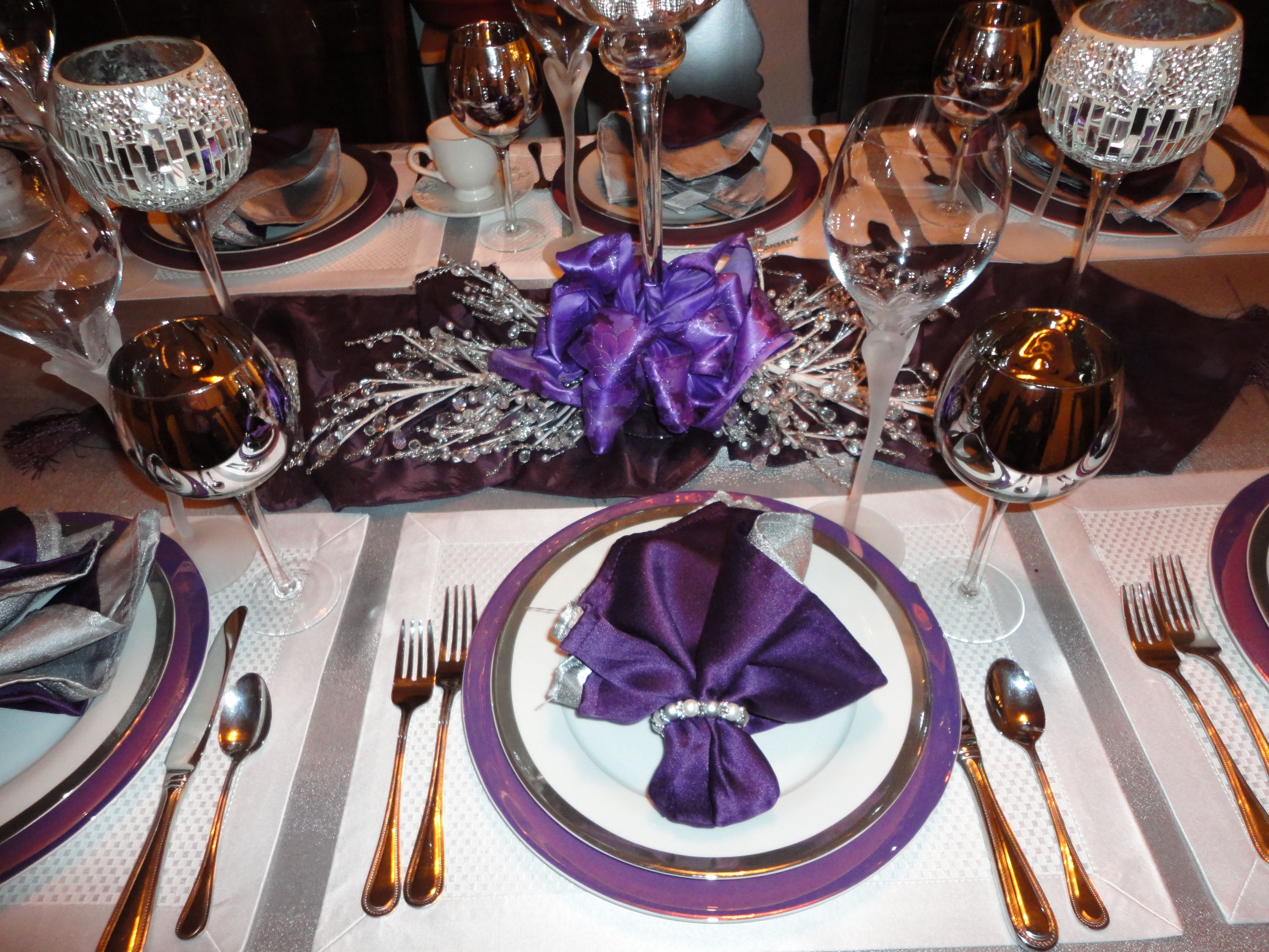 Purple charger, White plate, and purple napkin place setting. Silver ...