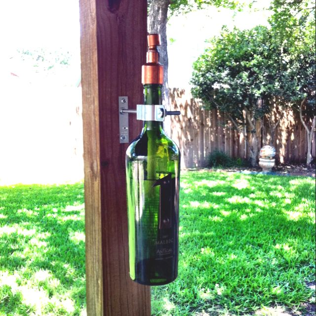Wine bottle tiki-torches on the back patio!