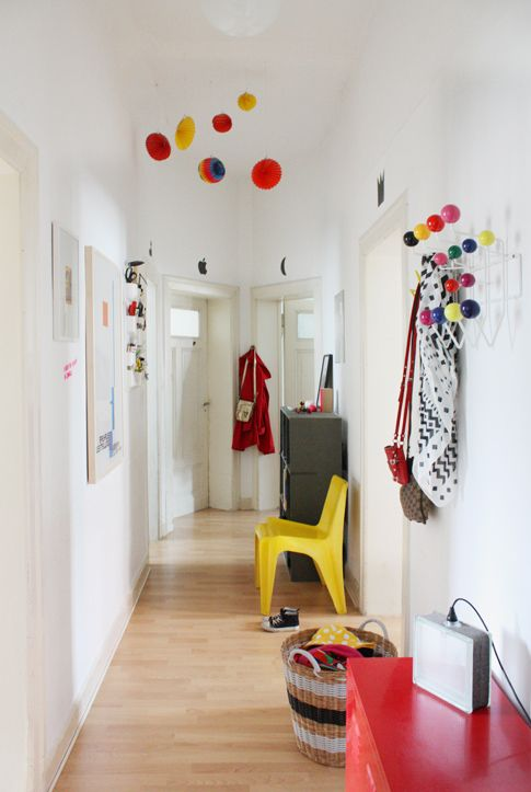 why not have a nice mobile in the entry way - great way to add color ...