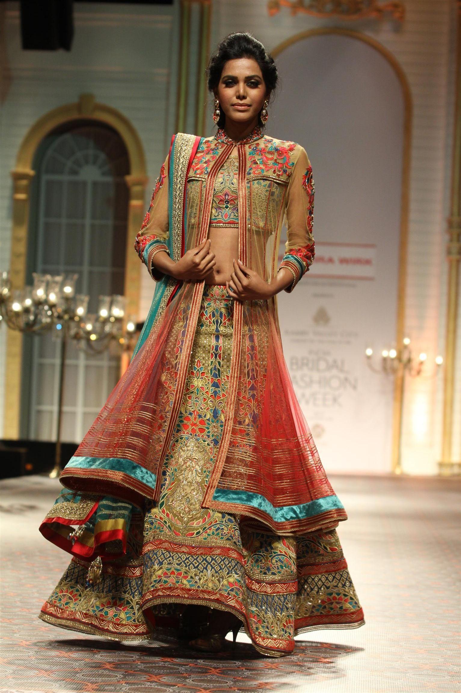 intricately embroidered wedding #lehenga design from Mandira Wirk at ...