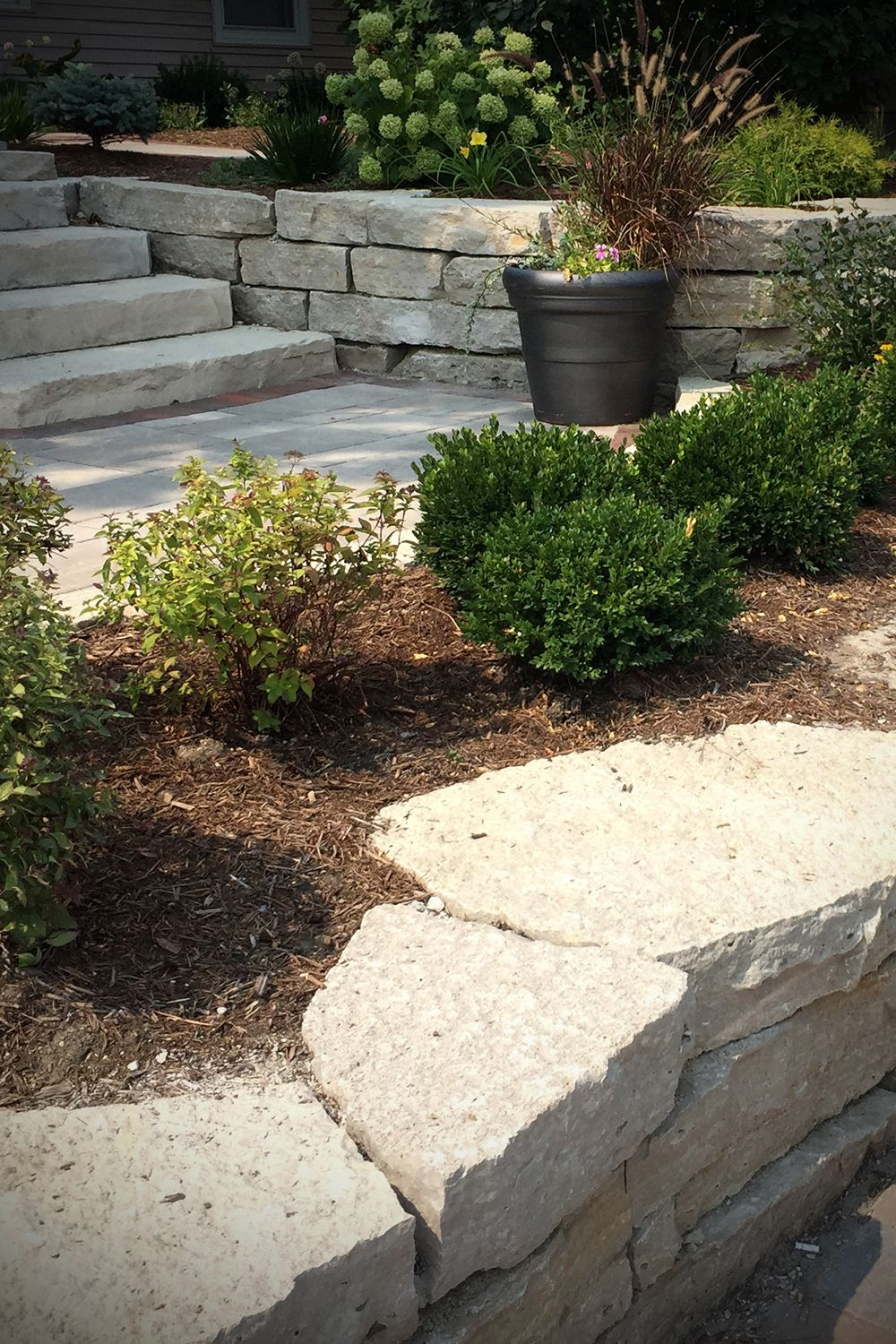 Home Landscape Retaining Wall Stone Design Fond Du Lac Outcroppings Small Backyard Landscaping Backyard Landscaping Garden Design