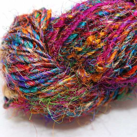 Love this ! Recycled Sari Silk Yarn Hank  Multicolour van SheerEthic op Etsy, $9.90 Hand spun from the discarded silk left overs from sari production in India. This waste silk is collected and then woven into these vibrant yarns by women in local villages creating important income that these women wouldn't otherwise have the opportunity to generate.