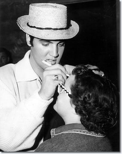 hey elvis whatcha doin? -oh, just signing my name on someone's forehead..no biggie.
