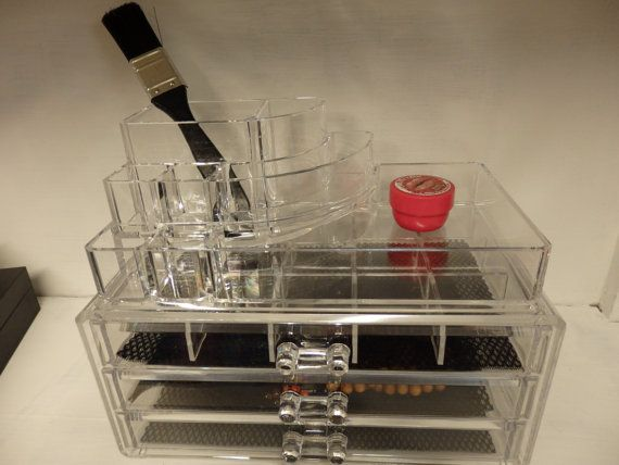 Bottom layer comprises 3 mini drawers.    Top layer comprises slots and compartments ideal for organizing small items and especially things that