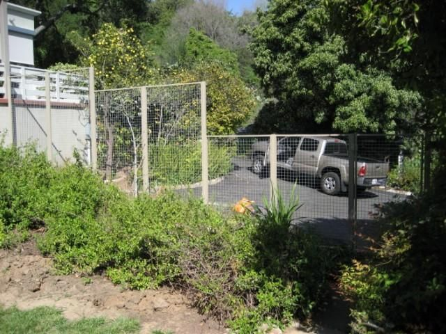 Western Fence Company, square grid metal fencing OUTDOORS