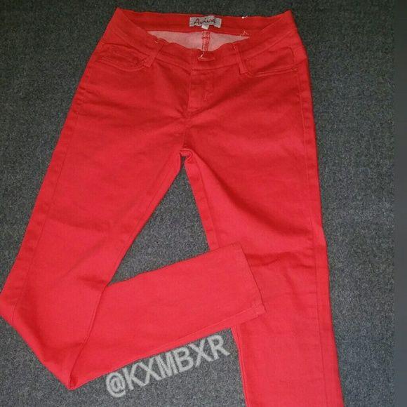 Red skinny jeans/pants.  Never worn but missing tags. These were too small for me but I had already removed the tags and I could not return them. They are not true blue jean material, more like a stretchy Jean material. Size 5. Listed as a 4 because I cannot select 5.  Smoke free home ! Aviva Pants Skinny