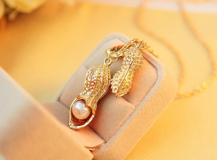 http://ru.aliexpress.com/item/2014-New-Hot-Elegant-Peanut-Shape-Gold-Color-Necklace-Sweater-Chain-Jewelry-Accessories/32243057608.html?spm=2114.41010708.4.47.iGWzLZ